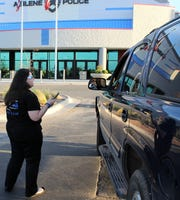 Jaime Boynton talks to someone who came to pray for Abilene police Tuesday evening. Those who came remained in their vehicles to give spiritual support to the department.