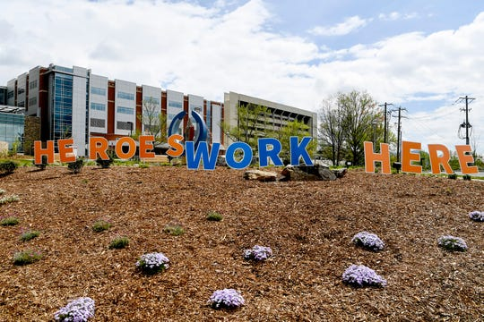 """Letters spelling """"Heroes work here"""" are seen in front of Mission Hospital April 8, 2020 during the coronavirus pandemic."""