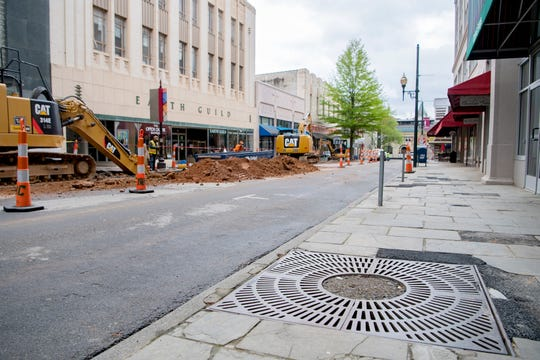 A planter sits absent a tree as a crew works on the Haywood Streetscape Improvement project on April 8, 2020. The project includes road resurfacing, stormwater fixed and sidewalk repairs.