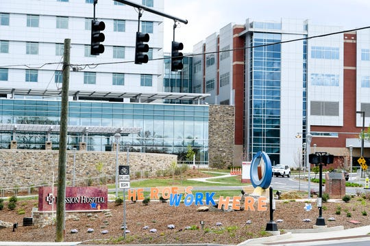 "Letters spelling ""Heroes work here"" are seen in front of Mission Hospital April 8, 2020 during the coronavirus pandemic."