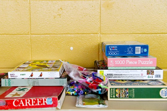 Puzzles are stacked in a hallway at Harrah's Cherokee Center Asheville as the facility is prepared to house homeless during the coronavirus pandemic.