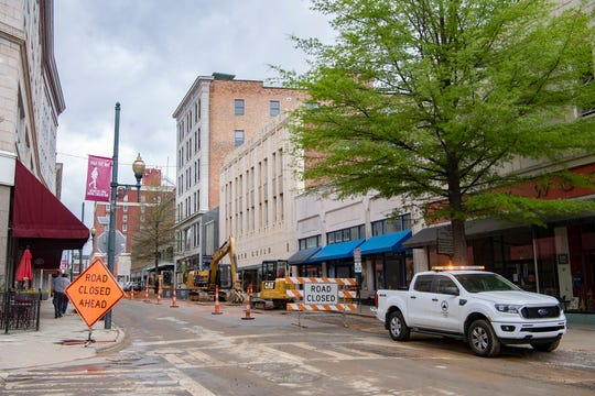 A crew works on the Haywood Streetscape Improvement project on April 8, 2020. The project includes road resurfacing, stormwater fixed and sidewalk repairs.