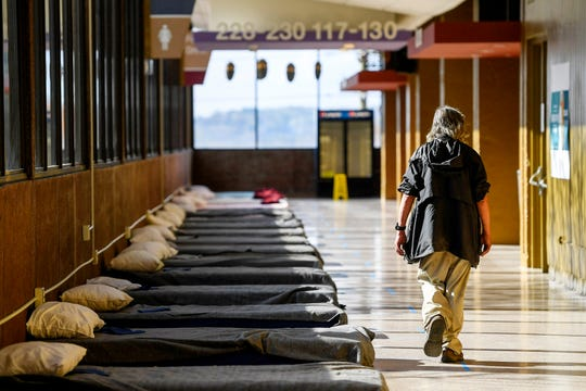 Cots are lined 6 feet apart in a hallway as Harrah's Cherokee Center is prepared to house homeless in the midst of the coronavirus pandemic Asheville April 8, 2020.
