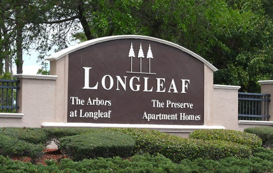 The entrance sign on Wickham Road for The Preserve at Longleaf apartments.