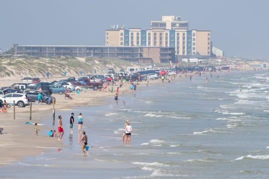 Crowds on the beach near Bob Hall Pier on Wednesday, April 8, 2020.
