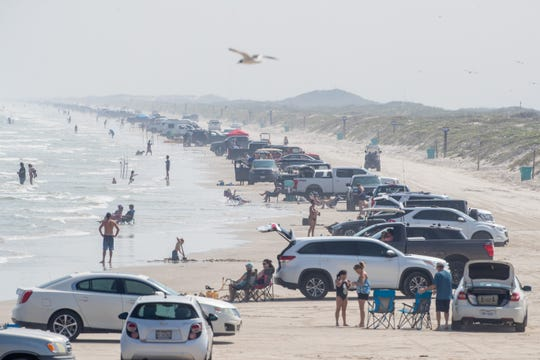 Crowds on the beach near Bob Hall Pier on Wednesday, April 8, 2020.