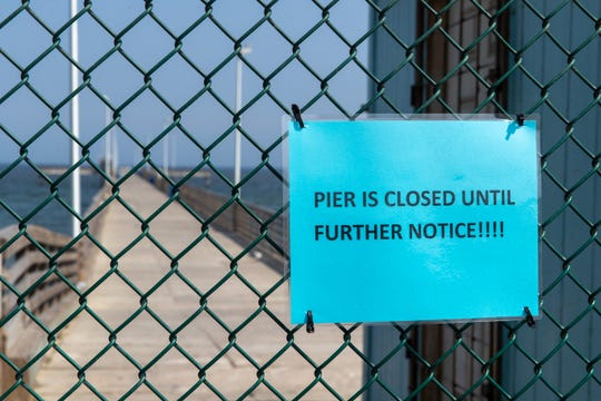 A closed sign was put up at Bob Hall Pier by Corpus Christi police on April 8, 2020.