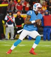 Photo illustration of Texans QB Deshaun Watson wearing a Texans' uniform in Oiler-like powder blue.