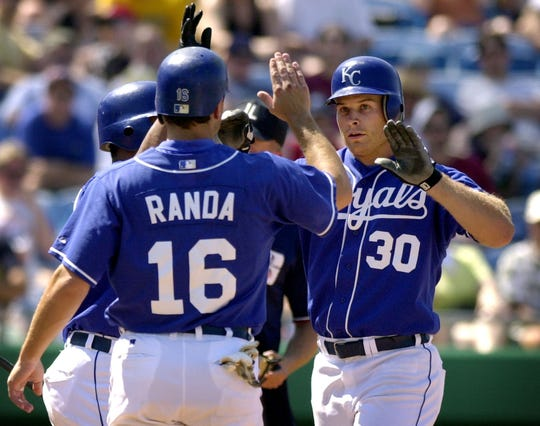 Kansas City Royals' Brandon Berger (30) is welcomed home by teammates after Berger hit a two-run home run in 2002.