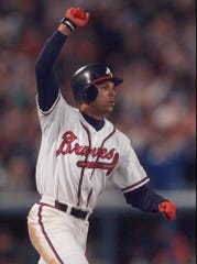 The Atlanta Braves' David Justice reacts after his sixth inning home run in Game Six of the World Series againdt the Cleveland Indians in 1995.