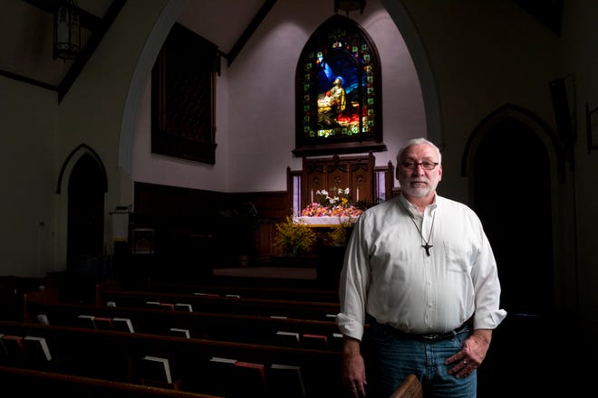 Rev. Keith Haithcock stands inside St John United Church of Christ in Bellevue, Ky., on Wednesday, April 8, 2020. Haithcock is filming Easter services on Friday to air on Easter Sunday at the church.