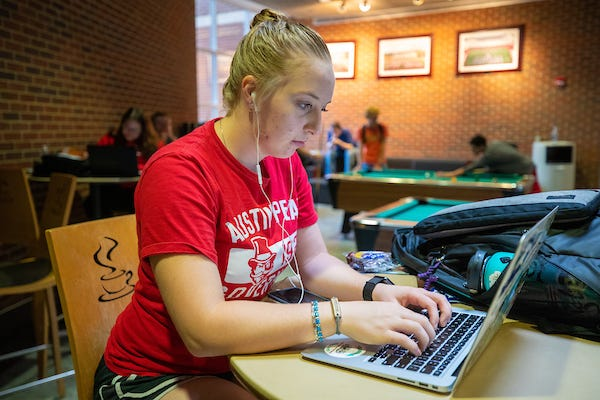 An APSU student works on her laptop prior to classes going all online.