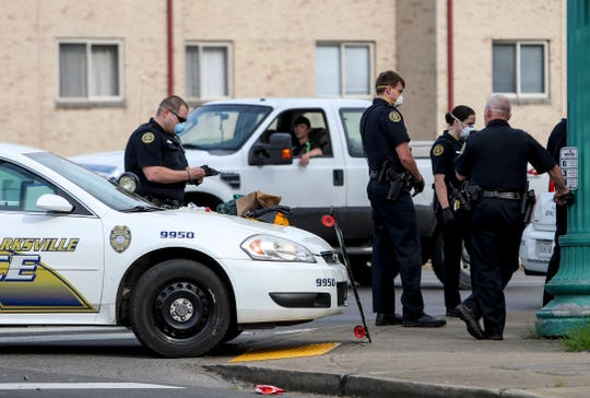 Clarksville Police officers equipped with face masks to prevent contamination or spread of the new COVID-19 coronavirus respond to the scene of an accident at the intersection of Madison St and University Ave in Clarksville, Tenn., on Tuesday, April 7, 2020.
