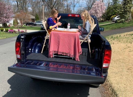 Jennifer Perrin set up a picnic area on the bed of her pickup truck.