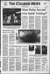 Front page of The Courier-News from April 16, 1974, showing kidnap victim Patricia Hearst iparticipating in the robbery of The Hibernia Bank in San Francisco, California.