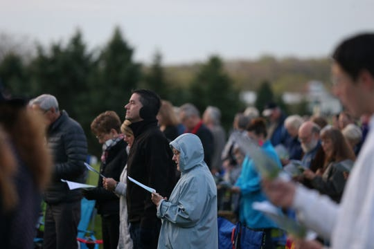 People gather on the south lawn of the Church of the Land at the Living History Farms during an Easter sunrise church service on April 16, 2017, in Urbandale.