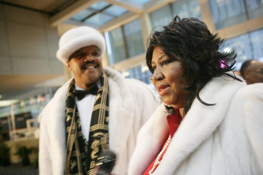 Detroit's Queen of Soul, Aretha Franklin, arrives at the North American International Auto Show Charity Preview on January 13, 2006, with her date, Willie Wilkerson. Wilkerson, 72, died Wednesday of COVID-19, his family said.