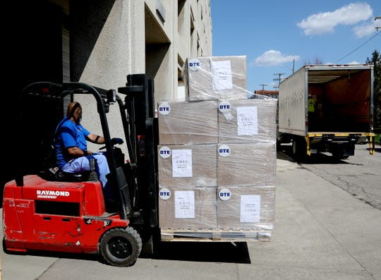 Cory Jones, 42 of Lincoln Park and a dock management worker for Henry Ford Health Systems backs up his forklift with a pallet of KN-95 masks that DTE donated to Henry Ford Health Systems in Detroit Michigan on April 8, 2020. The hospital is also in need of more gowns and other PPE items and hopes more donations will be coming in from others.