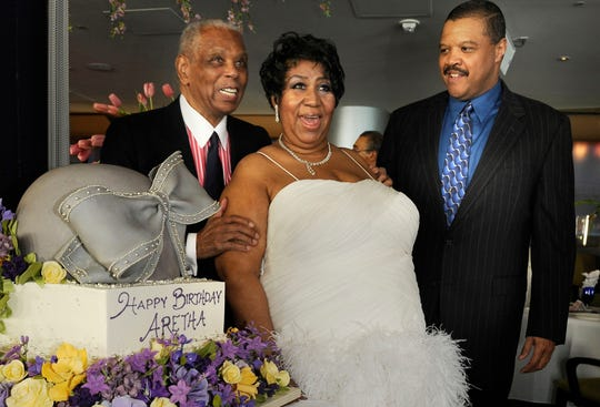 Judge Damon Keith, Aretha Franklin and Willie Wilkerson with Franklin's hat-shaped birthday cake at Seldom Blues in Detroit on March 21, 2009.