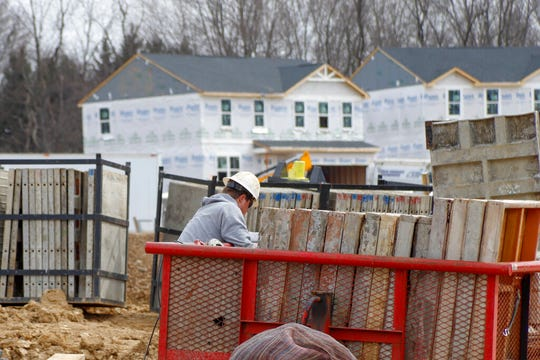 Construction continues at a housing plan in Zelienople, Pa., in this March 18, 2020, file photo.