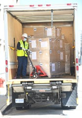 DTE's Ken Crandall helps unload over 100,000 KN95 masks from the DTE Foundation to Henry Ford Health System, to be distributed to hospitals across southeast Michigan, in Detroit, Michigan on April 8, 2020.