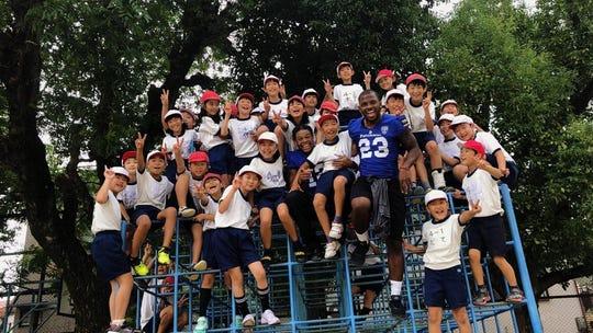 Joshua Cox visits a local school in Osaka with Panasonic Impulse teammates.