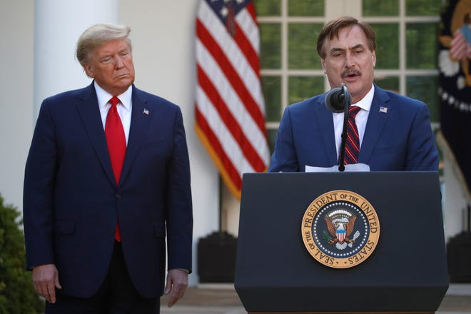 My Pillow CEO Mike Lindell speaks as President Donald Trump listens during a briefing about the coronavirus in the Rose Garden of the White House, Monday, March 30, 2020, in Washington.