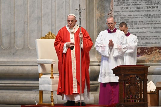 Pope Francis celebrates Palm Sunday Mass behind closed doors in St. Peter's Basilica, at the Vatican, Sunday, April 5, 2020, during the lockdown aimed at curbing the spread of the COVID-19 infection, caused by the novel coronavirus.