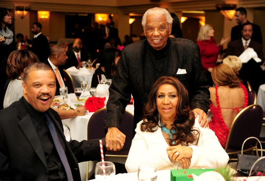 Willie Wilkerson, Federal Judge Damon Keith and Hostess Aretha Franklin at Franklin's annual Christmas Party at the International Banquet Center in Detroit's Greektown on December 22, 2012.