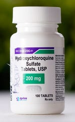 A bottle of hydroxychloroquine is displayed on a table outside The Resort at Texas City nursing home Tuesday, April 7, 2020, in Texas City, Texas.