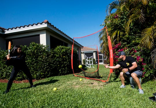 Lehigh Acres resident and current Pensacola Blue Wahoos manager Ramon Borrego trains with his daughter Maria at their home on Wednesday, April, 8, 2020. He is stuck at home because of the COVID-19 pandemic  and would be starting the season right now. The Wahoos are part of the Minnesota Twins organization. He has been with the organization for his whole career as a player and coach including with the Fort Myers Miracle that won the 2018 Florida State League Championship.