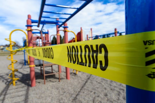 The playground equipment at Meadow Lark Elementary School is wrapped in caution tape to warn potential users that the playground is closed as social distancing continues to combat the spread of the coronavirus.