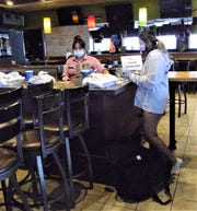 Good to Go driver Carmella Navarrete picks up to-go orders at Applebee's Bar and Grill in Tamuning April 8.