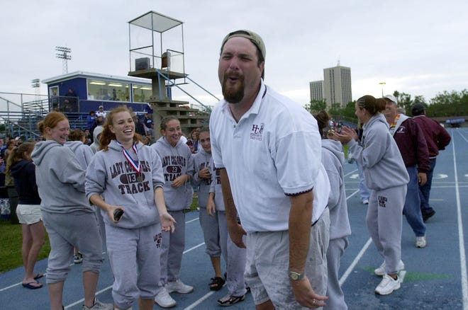Henderson County girls track coach Pat Rowland reacts after his girls doused him with a bucket of ice water as they await the official word that they had won the 3-A state title in Lexington Saturday evening, May 31, 2003.
