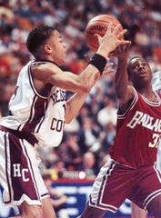 Henderson County's Adrian Armstead, left, pushes the ball past Ballard's Daniel Chiles during the first half of their Sweet Sixteen first round game Wednesday, March 13, 1996, in Lexington, Ky.