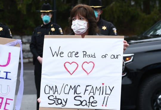 Community members joined in the send off for two busloads of Cayuga Health medical professionals as they left for New York Presbyterian Hospital in NYC to provide needed support for COVID-19 pandemic on Wednesday, April 8, 2020.