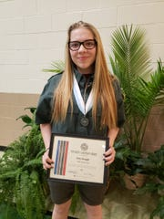 Zoey Keagle with her Venturing Leadership Award.