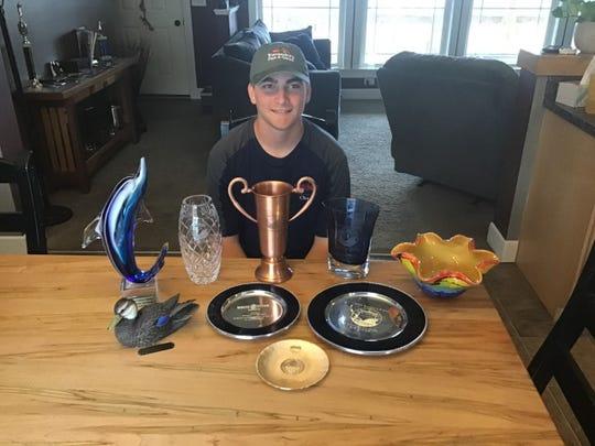 Chase Wojtanik with his trap shooting awards.
