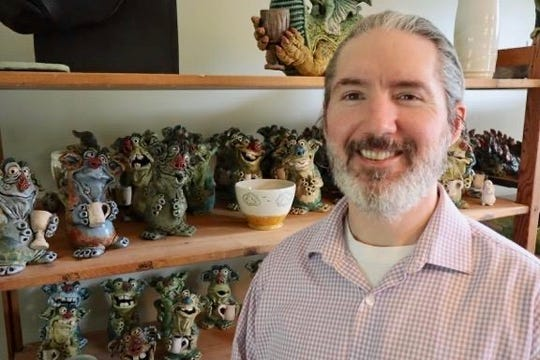 Sam Clark of Madison works in his studio where he crafts friendly creatures and coffee mugs.