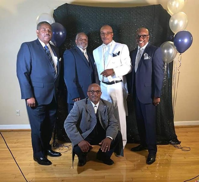 Terry Benton, far left, died on Monday morning from complications from COVID-19. His brother is Ronald Benton, second from the right, who is the pastor of Mt. Moriah Baptist Church in Jackson. They're pictured here with their brothers Roderick, Michael and Manford.