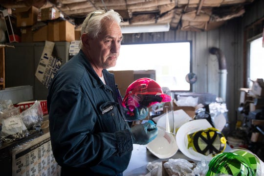 Anderson Commissioner Tim Isbel holds one of the hardhat   face shields he and fellow commissioner Catherine Denenberg are putting together to donate to Anderson County emergency workers on Wednesday, April 8, 2020. The face shield is a polycarbonate sheet that Isbel machines at his business Ultimate Fluid Power. The shield is then bolted to the front of the hard hard to help protect against the coronavirus.