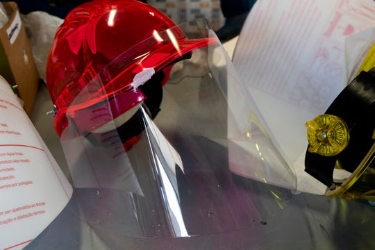 Anderson Commissioners Tim Isbel and Catherine Denenberg are installing face shield on hardhats for emergency workers. The face shields are an extremely flexible polycarbonate sheet that Isbel machines at his business Ultimate Fluid Power and Rocky Top Marketing and Manufacturing.