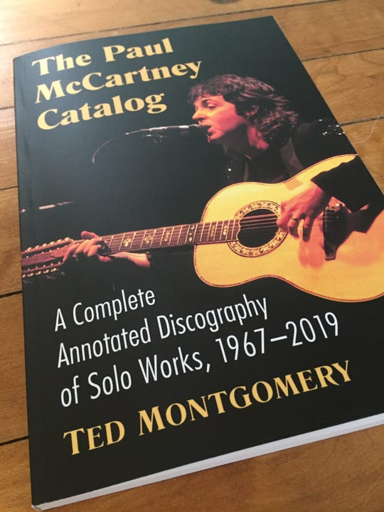 Brighton author Ted Montgomery wrote a book covering 52 years of Paul McCartney's solo career. A copy of the book is shown, Wednesday, April 8, 2020.