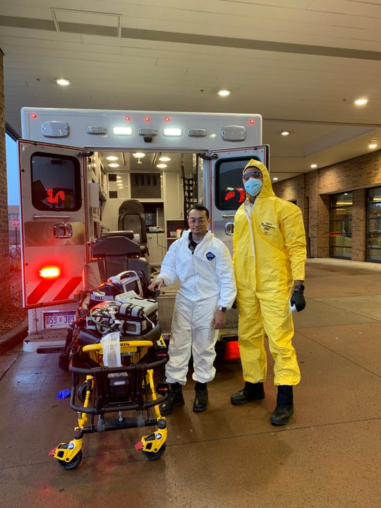 Thufe Miah, left, and his partner, Aaron Hatter, have transported numerous patients as Livingston County EMS paramedics during the coronavirus pandemic.
