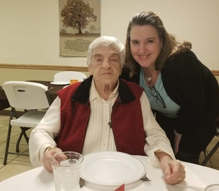 Lee Anne Teague (right) poses for a photo with her grandmother, Jean Massamore during a Thanksgiving meal at Massamore's Kentucky nursing home in November 2019. Massamore passed away April 4 after testing positive for the coronavirus.