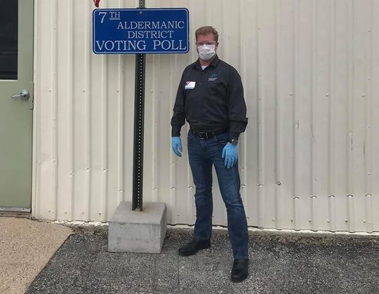 Manitowoc Mayor Justin Nickels works the polls on election day during the coronavirus pandemic April 7.