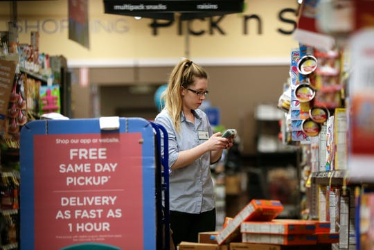 Cheyanne Carlton picks and bags items for customers' pickup and delivery orders on Tuesday, April 7, 2020 in Pick 'n Save at 250 West Holt Avenue. During coronavirus pandemic, more and more people choose to order groceries online and pick up groceries, rather than shopping in a store.