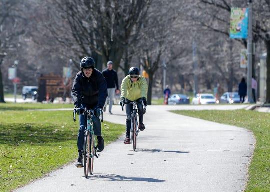 People bike and walk Saturday on the Oak Leaf Trail in Milwaukee.
