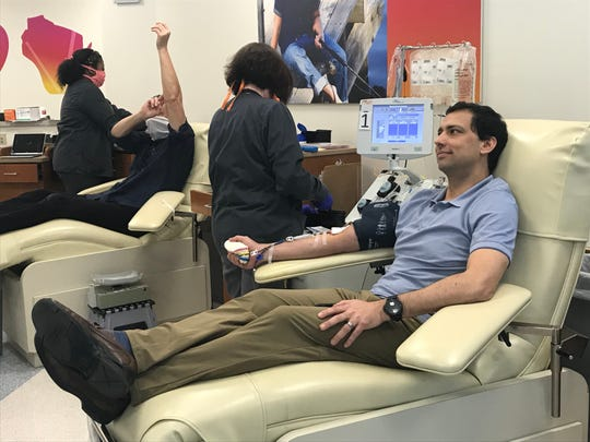 Dr. Dave Lal, a pediatric surgeon at Children's Hospital of Wisconsin who tested positive for the coronavirus in March, was the first person to donate plasma to the Versiti Blood Center of Wisconsin'sconvalescent plasma program.