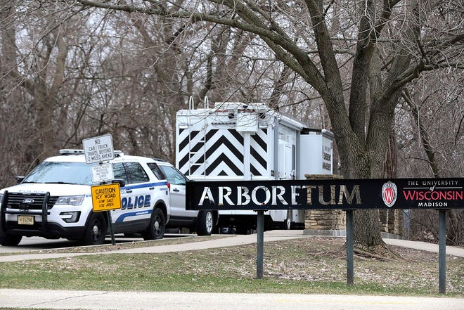 Vehicles from the Madison Police Department, Dane County Sheriff's Office and the University of Wisconsin Police Department are stationed outside the UW-Arboretum in Madison as law enforcement personnel investigate a double homicide March 31.